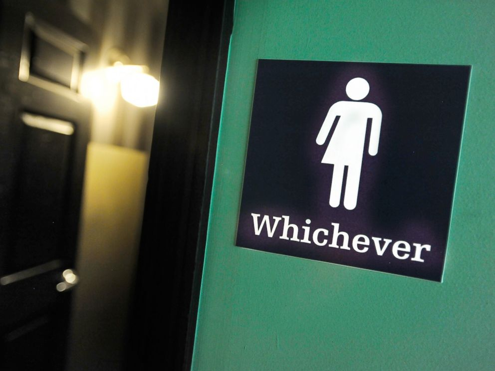 PHOTO: A gender neutral sign is posted outside a bathrooms at Oval Park Grill on May 11, 2016 in Durham, North Carolina.