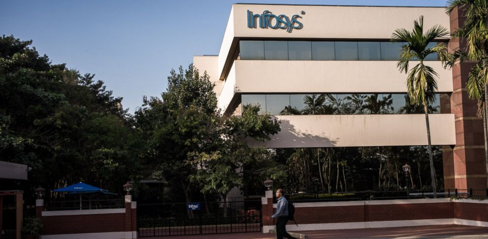 PHOTO: An man walks past the Infosys Ltd. campus in Electronics City in Bangalore, India, Feb. 4, 2013.
