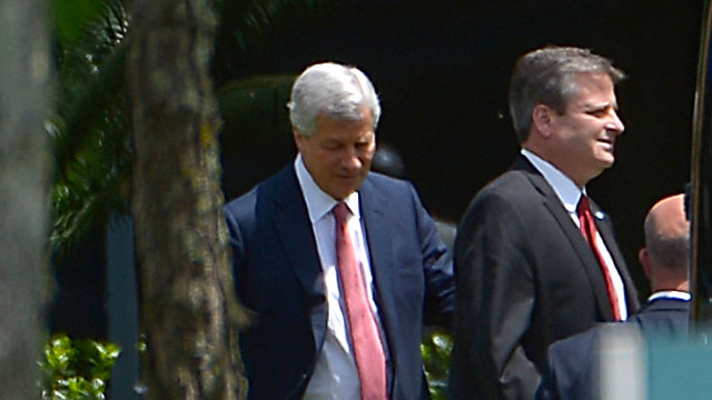 PHOTO: Jamie Dimon, chairman and CEO of JPMorgan Chase, left, and an unidentified man leave the companys annual shareholders meeting in Tampa, Fla., May 21, 2013.
