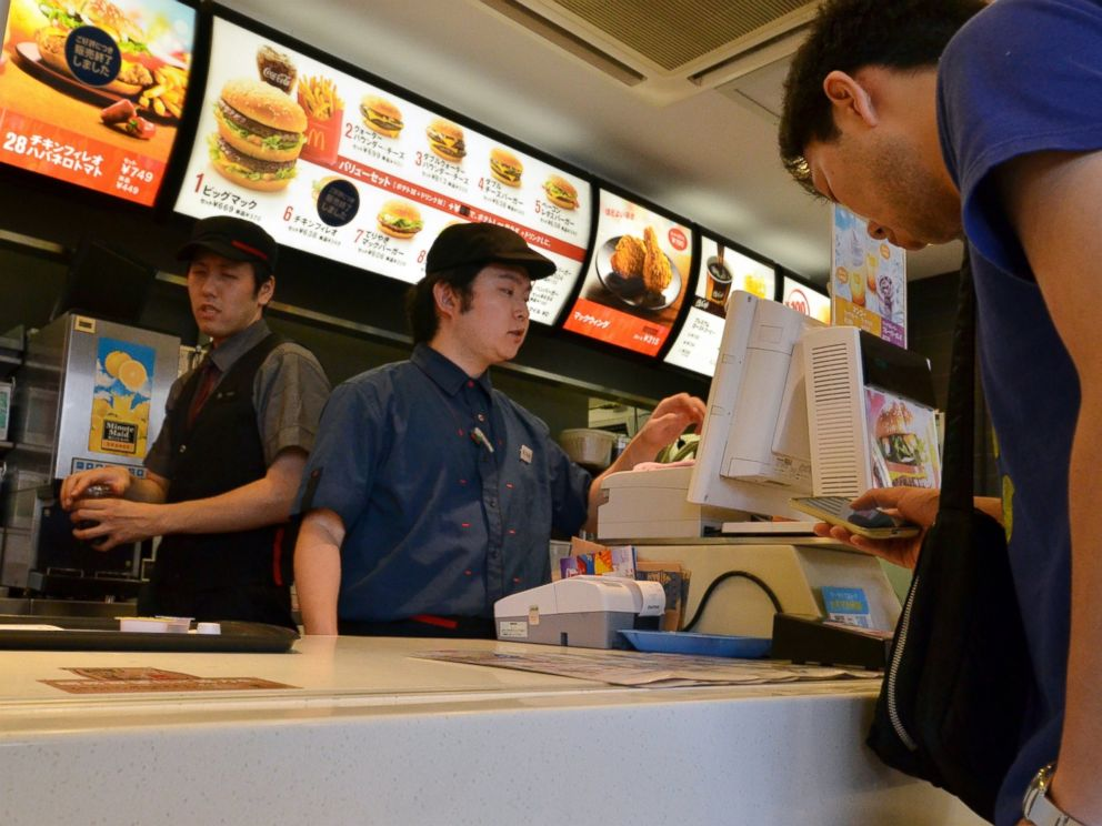 PHOTO: A customer orders food at a McDonalds restaurant in Tokyo, July 25, 2014.