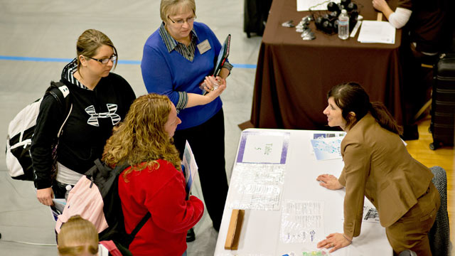 PHOTO: Job seekers speak to a representative at a job fair at Illinois Valley Community College (IVCC) in Oglesby, Ill. on April 10, 2013.