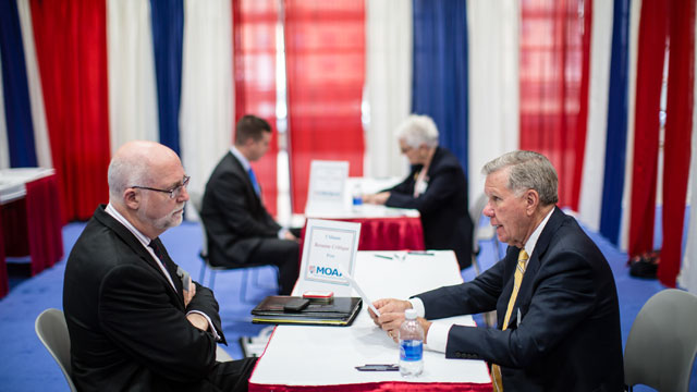 PHOTO: Jerry Crews, right, critiques the resume of a job seeker at the Military Officers Association of America career fair, April 24, 2012 in Washington, DC.