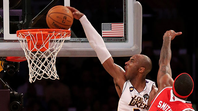 PHOTO: Kobe Bryant #24 of the Los Angeles Lakers dunks over Josh Smith #5 of the Atlanta Hawks at Staples Center on March 3, 2013, in Los Angeles.