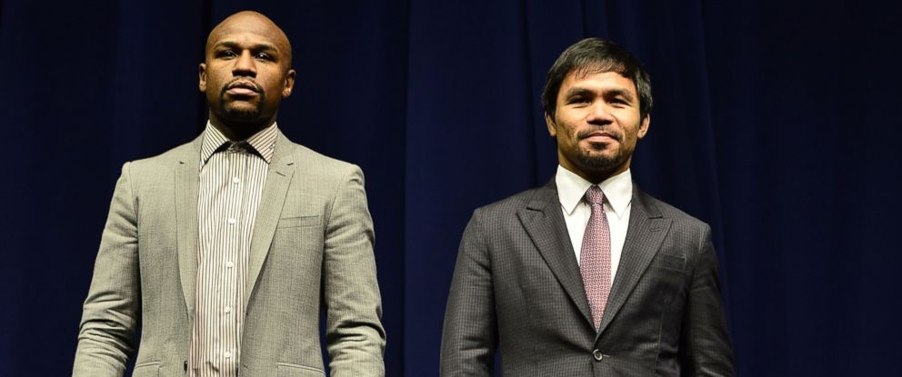 PHOTO: Floyd Mayweather and Manny Pacquiao attend a press conference at Nokia Theatre L.A. Live on March 11, 2015 in Los Angeles, Calif.