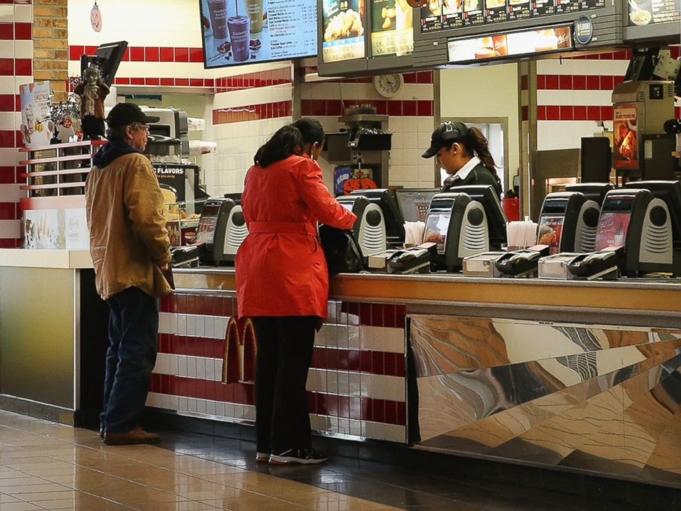 PHOTO: Customers order food from a McDonalds restaurant on Oct. 24, 2013 in Des Plaines, Ill.