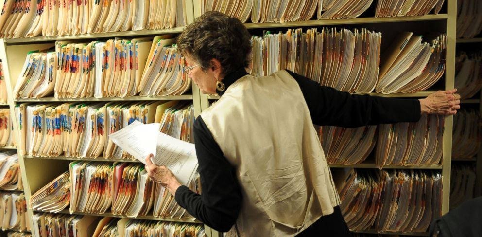 PHOTO: Admission clerk Joan Vest is refiling and degitalizing the medical records of patients at Spanish Peaks Family Clinic in Walsenburg, Colo. on March 9, 2011.