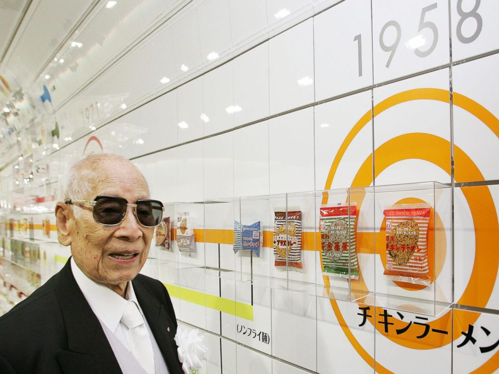 PHOTO: Momofuku Ando, the founder of Japans Nissin Food Products Co., poses next to a package of companys historic first bag of chicken ramen which was introduced in 1958 at the refurbished Instant Ramen Museum in Osaka, Japan on Nov. 25, 2004.