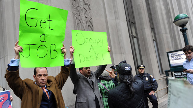 PHOTO: Derrick Tabacco, left, a small business owner, and an unidentified man counter demonstrate against the Occupy Wall Street march near the New York Stock Exchange, Nov. 17, 2011 in New York.