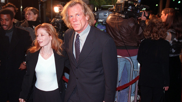 """PHOTO: Actor Nick Nolte(R), who has a role in the film """"The Thin Red Line,"""" arrives to the premiere of the movie with television actress Vicky Lewis(L) 22 December in Beverly Hills. The film also stars Sean Penn, who did not attend the premiere."""