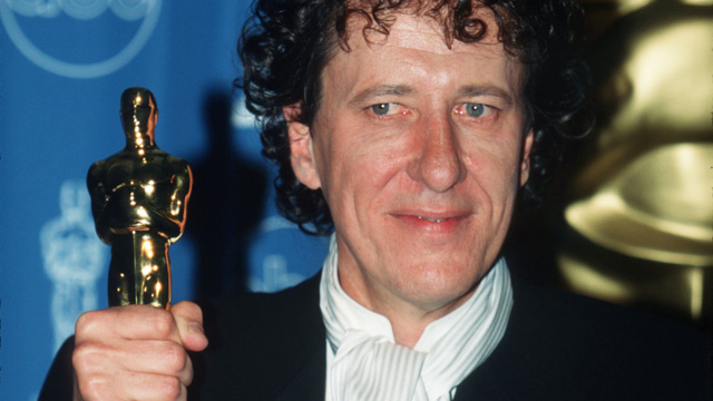 """PHOTO: Geoffrey Rush holds his award for Best Performance By An Actor In A Leading Role for the film """"Shine"""" backstage at the 69th Annual Academy Awards ceremony March 24, 1997 in Los Angeles, CA."""