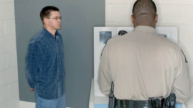 PHOTO: Man having his mugshot taken