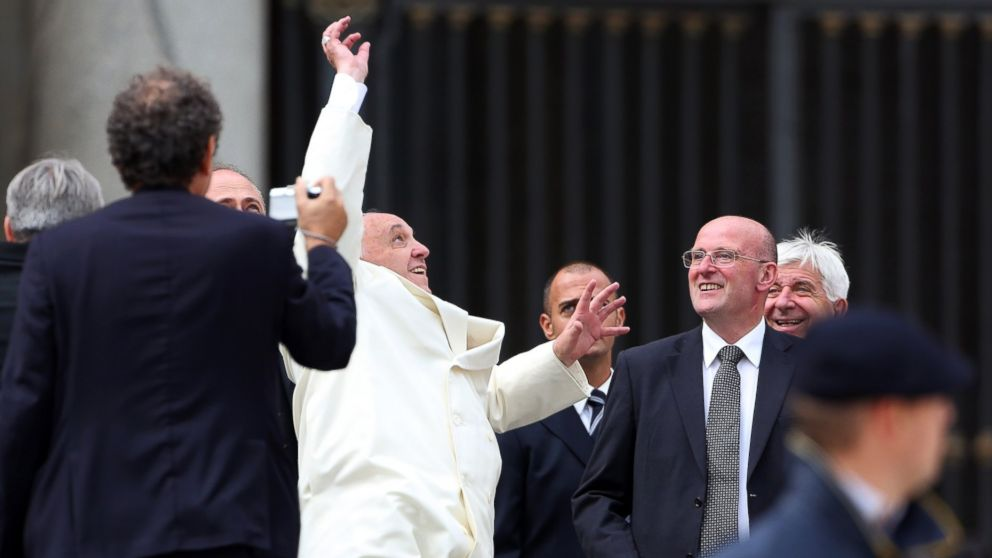 Pope Francis jumps to catch a baseball ball thrown by a faithful at the end of his weekly audience at St. Peter's Square on Sept. 24, 2014 in Vatican City, Vatican.