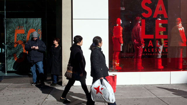 PHOTO: Shoppers walk past window displays on 34th Street, Dec. 26, 2011 in New York City.