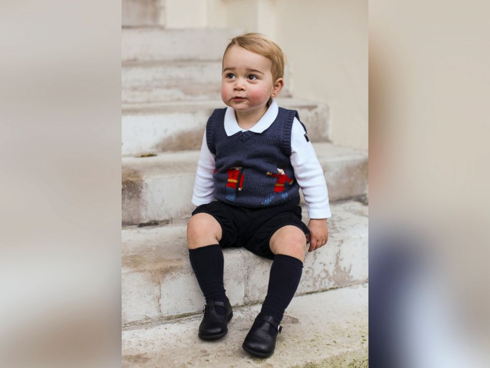 PHOTO: In this handout image released on Dec. 13, 2014 by Kensington Palace, Prince George sits for his official Christmas picture in a courtyard at Kensington Palace in late Nov., 2014 in London