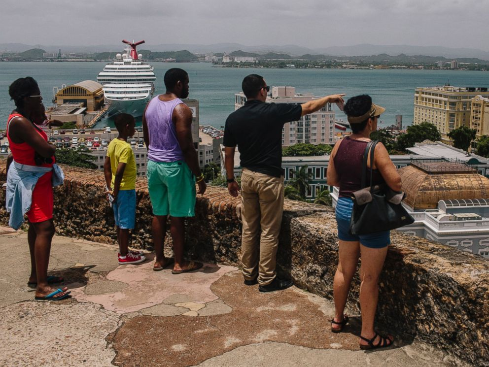 PHOTO: People look out over the Old City of San Juan, Puerto Rico, on July 8, 2015.
