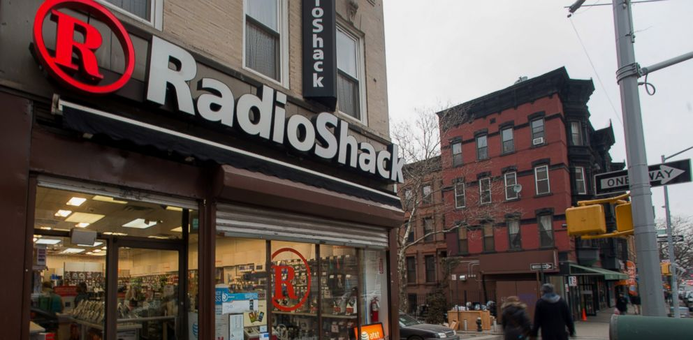 PHOTO: Pedestrians pass in front of a RadioShack Corp. store in New York on March 2, 2014.