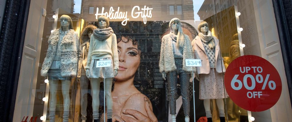 PHOTO: A sale sign is displayed next to mannequins in the window of a Hennes & Mauritz AG (H&M) store in New York City, Dec. 5, 2014.