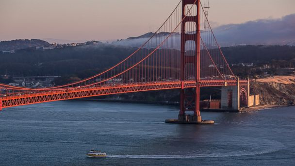PHOTO: A tour boat travels under the Golden Gate Bridge as viewed from the Marin Headlands on Oct. 20, 2013, in San Francisco, Calif.