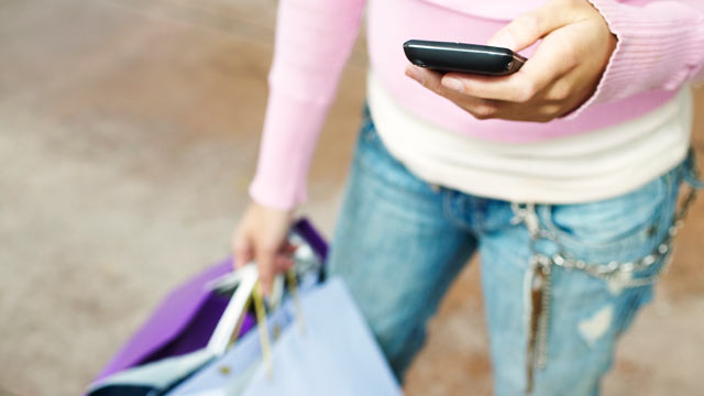 PHOTO: Shoppers can use their mobile devices and check-in apps for deals sometimes without making a purchase.