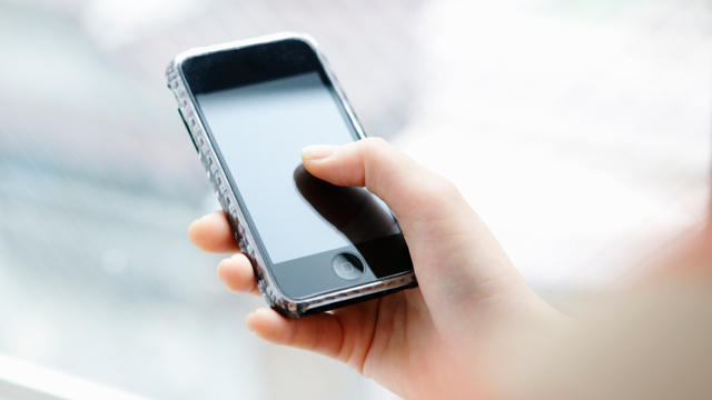 PHOTO: Woman using smartphone