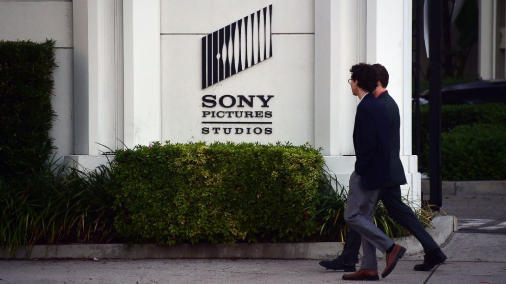 Pedestrians walk past an exterior wall to Sony Pictures Studios in Los Angeles, Calif. on Dec. 4, 2014.