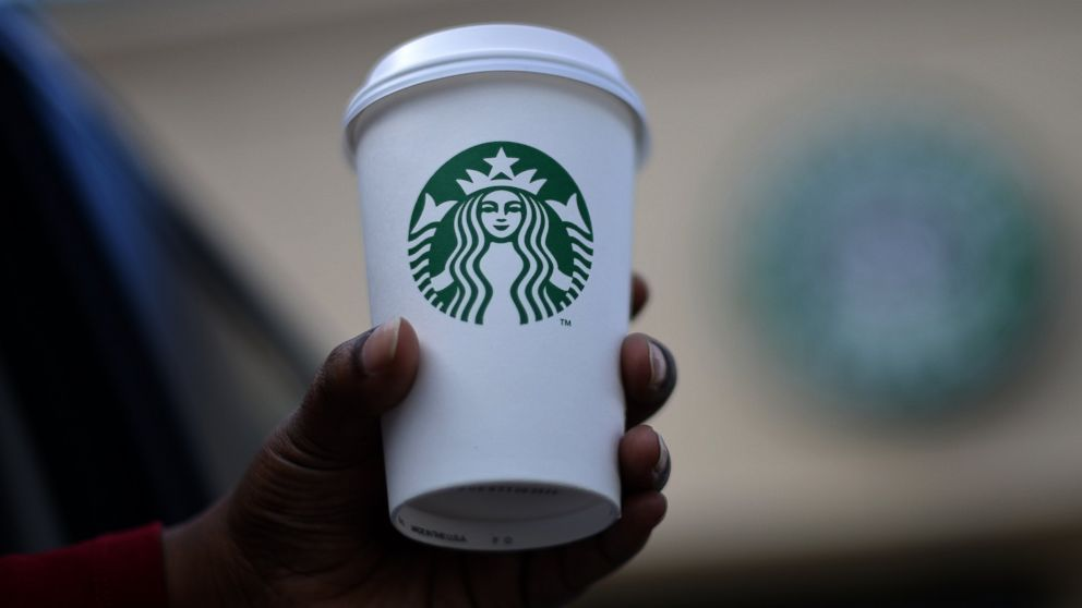 A woman holds a Starbucks coffee cup in this file photo, March 28. 2013, in Silver Spring, Md.