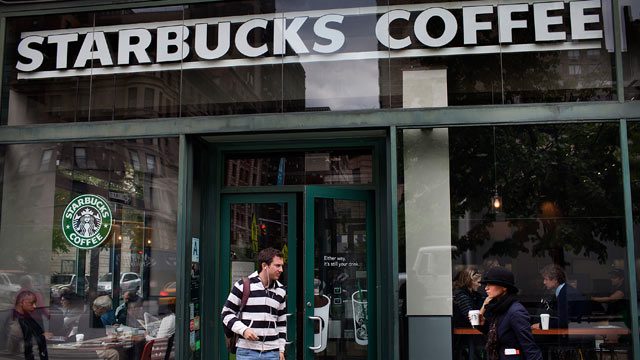 PHOTO: A customer exits a Starbucks Corp. store in New York.