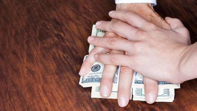 PHOTO: Hand stopping man from taking money