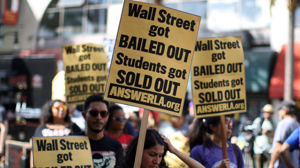 In this Sept. 22, 2012 fiel photo, students protest the rising costs of student loans for higher education in the Hollywood section of Los Angeles, California.