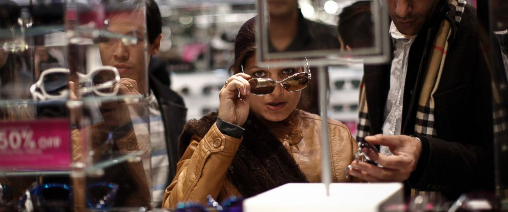PHOTO: Customers shop for sun glasses at Macys Herald Square after the store opened its doors at 8pm Thanksgiving day on Nov. 28, 2013 in New York City.