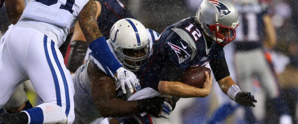 PHOTO: Cory Redding #90 of the Indianapolis Colts tackles Tom Brady #12 of the New England Patriots in the third quarter of the 2015 AFC Championship Game on Jan. 18, 2015, in Foxboro, Mass.