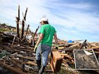 PHOTO: Brian Vitsmun sorts through debris at his home that was destroyed by a tornado on June 2, 2013 in Moore, Okla.