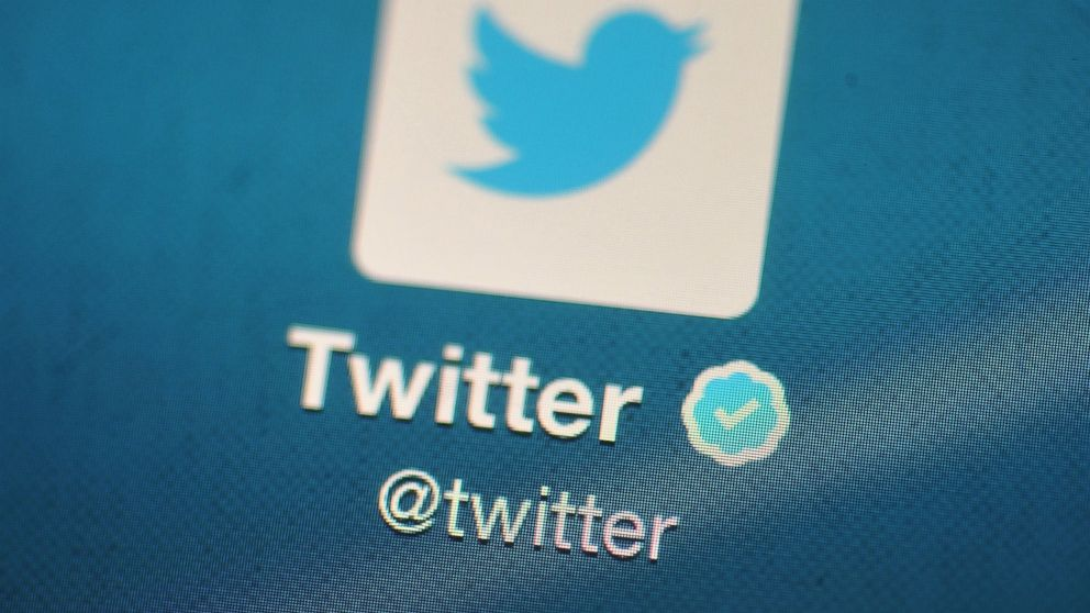 In this photo illustration, The Twitter logo is displayed on a mobile device.