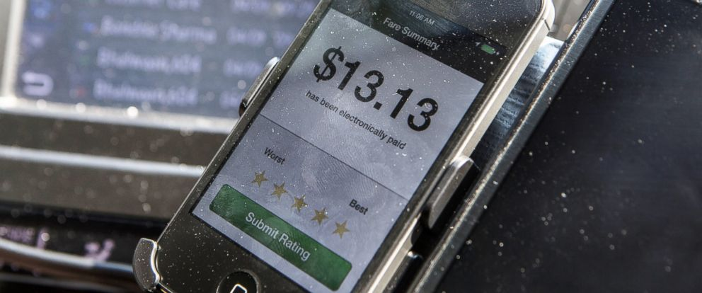 PHOTO: A fare summary is displayed on the Uber app in the car of an UberX driver on April 9, 2014, in Washington, DC.