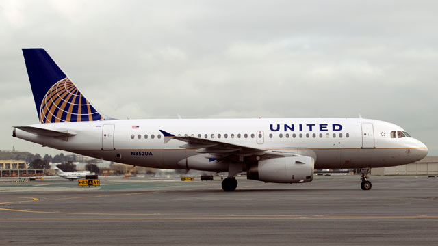 PHOTO: An Airbus A319 jet painted in United Continental Holdings Inc.s new livery following the airlines merger taxis down the runway at San Francisco International Airport in San Francisco, California, U.S., on Feb. 23, 2011.