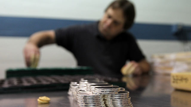 PHOTO: A worker sorts trays of silver blanks that will be used for the National Medals at the West Point Mint, May 18, 2012 in West Point, New York.