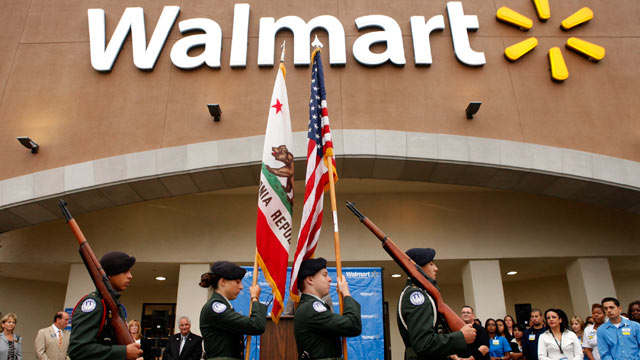 PHOTO: The North Torrance High School Junior Reserve Officer Training Corps color guard presents the U.S. flag and California state flag before the grand opening of a new Wal-Mart Stores Inc. location in Torrance, Calif, Sept. 12, 2012.