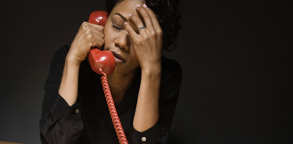 PHOTO: Exasperated woman on telephone