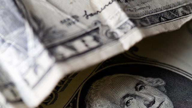 PHOTO: Crumpled dollar bills.