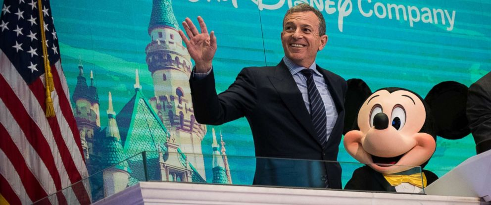 PHOTO: (L to R) Chief executive officer and chairman of The Walt Disney Company Bob Iger and Mickey Mouse look on before ringing the opening bell at the New York Stock Exchange, November 27, 2017 in New York City.