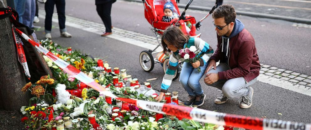 PHOTO: People lay flowers outside a kebab shop in Halle, Germany, Oct. 10, 2019, after two people were killed in a shooting.