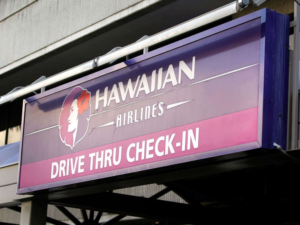 PHOTO: An information sign is displayed at an airport in Honolulu, Hawaii, for travelers to check in with Hawaiian Airlines Inc., 9. January 2013.