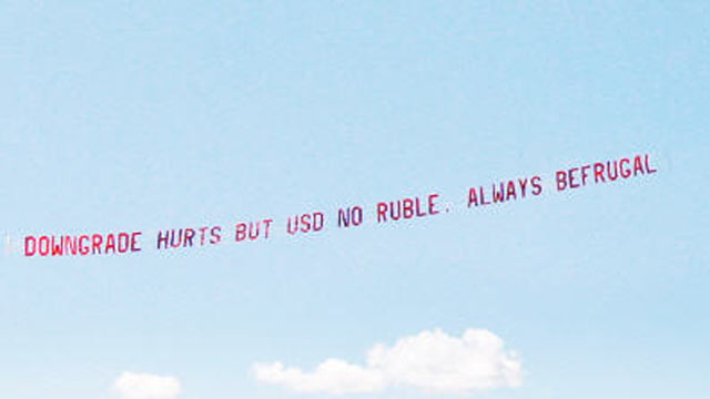 "PHOTO: ""Downgrade hurts but USD no ruble. Always be frugal,"" was the message on the banner over the Financial District, August 11, 2011, paid for by Jon Lal, 43, a Boston-based businessman who runs a website, befrugal.com."