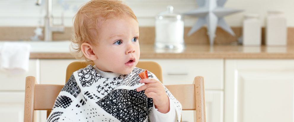 PHOTO: A large burp cloth by baby brand aden + anais serves a dual purpose as a bib with hidden snap buttons.