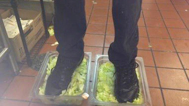 PHOTO:  An Ohio burger king employee posted a photo of himself standing in two tubs of lettuce.