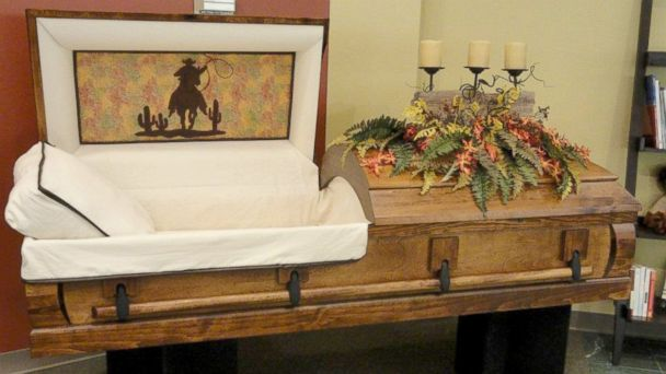 """PHOTO: Til We Meet Again, a company specializing in caskets and urns, has outlets in malls in Texas, Louisiana, Indiana, and Kansas. This is a """"western"""" themed casket."""