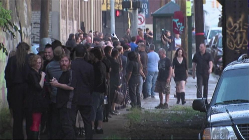 A crowd gathers and waits to participate in the unveiling event of a statue depicting Satan, July 25, 2015, organized by the Detroit Temple of Satan.