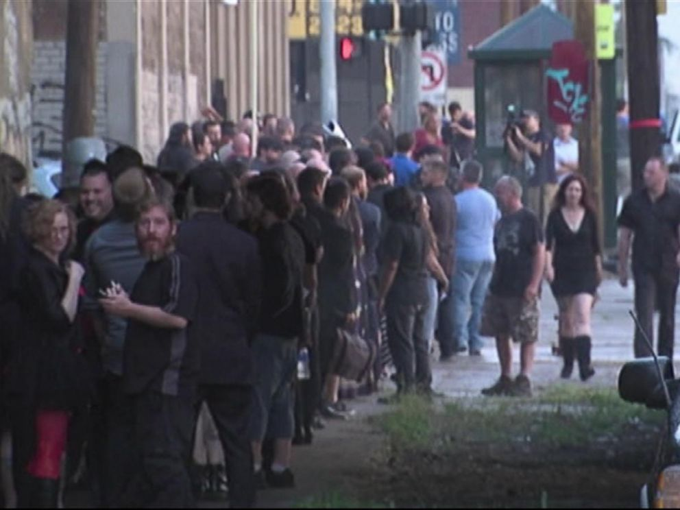 PHOTO: A crowd gathers and waits to participate in the unveiling event of a statue depicting Satan, July 25, 2015, organized by the Detroit Temple of Satan.