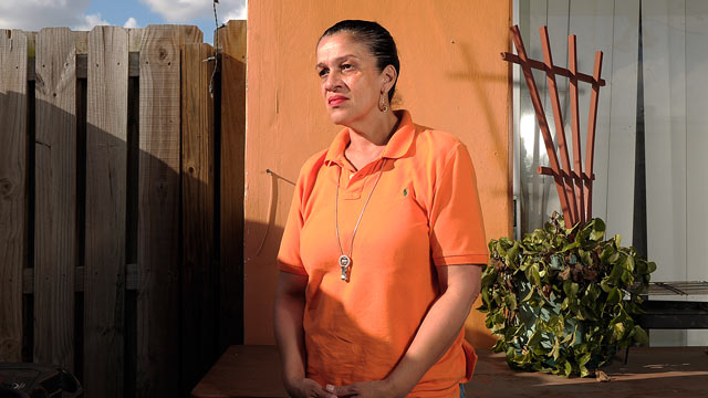 PHOTO: Janice Doble, 50, of Sunrise was fired from her job at Elizabeth Wellborn Law firm for wearing an orange shirt, March 16, 2012. Doble who was a supervisor of the scan-copy-mailroom wore orange as part of a group going to happy hour.