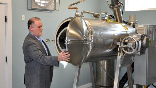 PHOTO: Funeral director Mark Riposta stands next to the first alkaline hydrolysis cremation machine in use in the state of Maine.